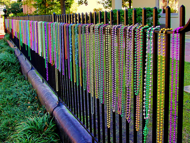 Mardi Gras Beads on fence