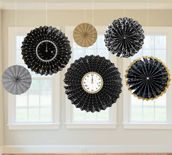 Hanging paper fans with clocks for New years eve!