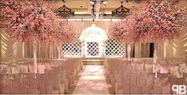 Love these cherry blossom trees at this wedding ceremony!