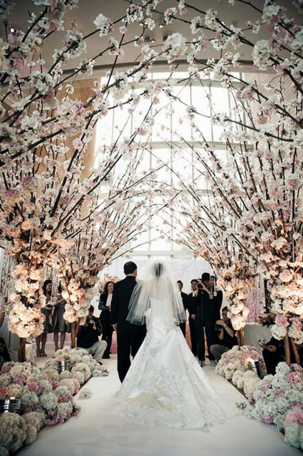 Love these white blossoming trees at this wedding ceremony