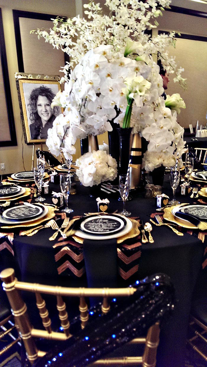 My Favorite Tablescape Black and gold Modern table with tons of floral- B. Lovely Events