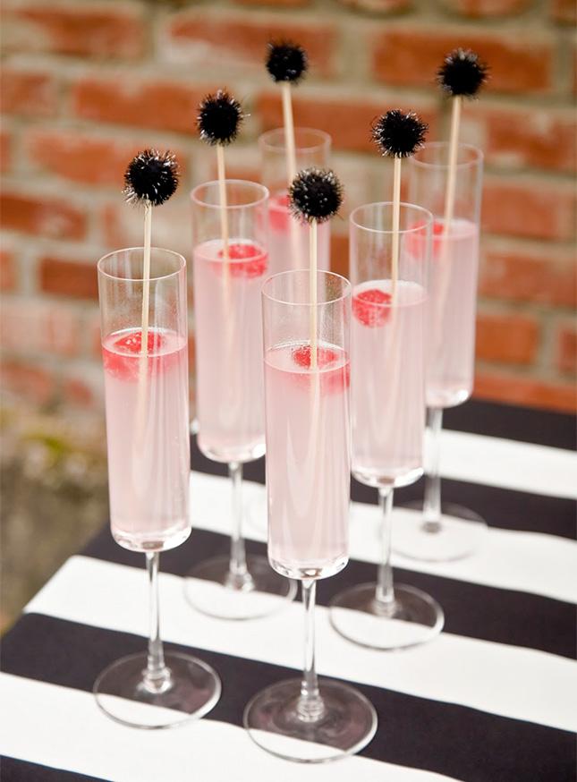 Black pom swizzle sticks for oscar party drinks