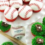 baseball cupcakes with minibaseball bat decorations