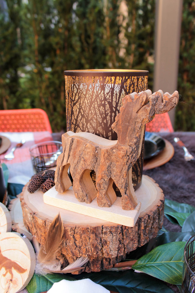 Love this adorable wooden deer on this ourdoor natural tablescape! - See More Woodsy Tablescape Details On B. Lovely Events