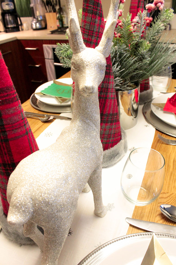 This reindeer is too cute on this chirstmas tablescape from B. Lovely Events