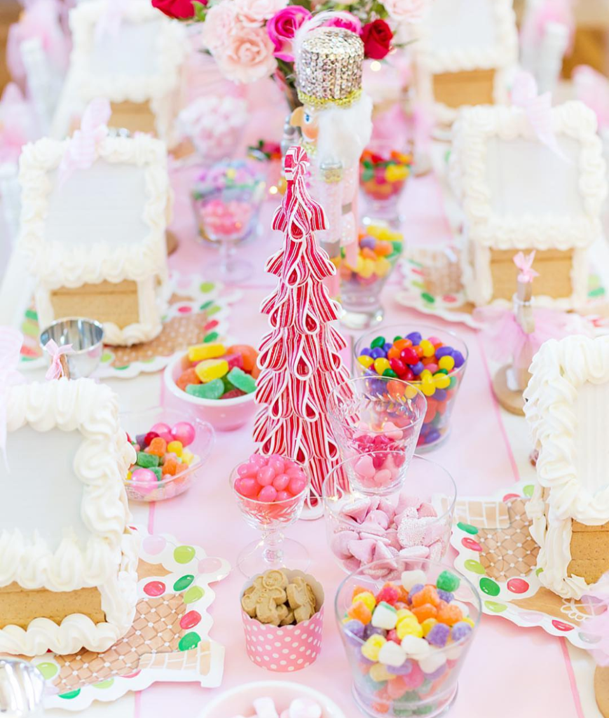 Love all of the pink details of the darling GIngerbread house party! - See more pink Christmas ideas on B. Lovely Events! #christmas #christmasparty #christmasideas #christmasdecor