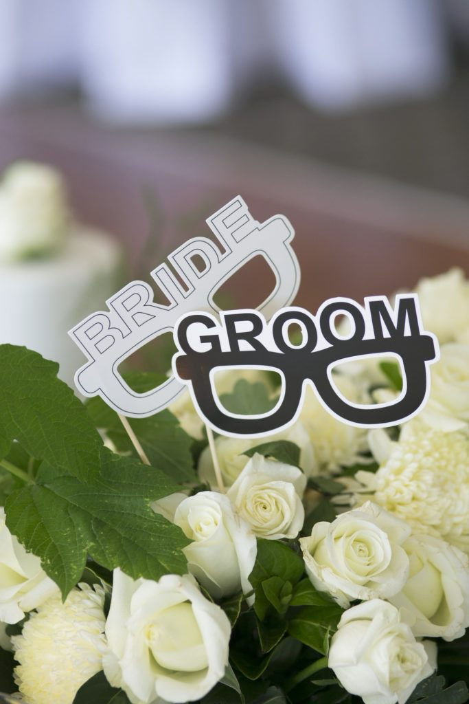 Bride and groom photobooth props- See all the beautiful details on B. Lovely Events! #wedding #realwedding #weddingideas #weddingtips #weddingdecorations
