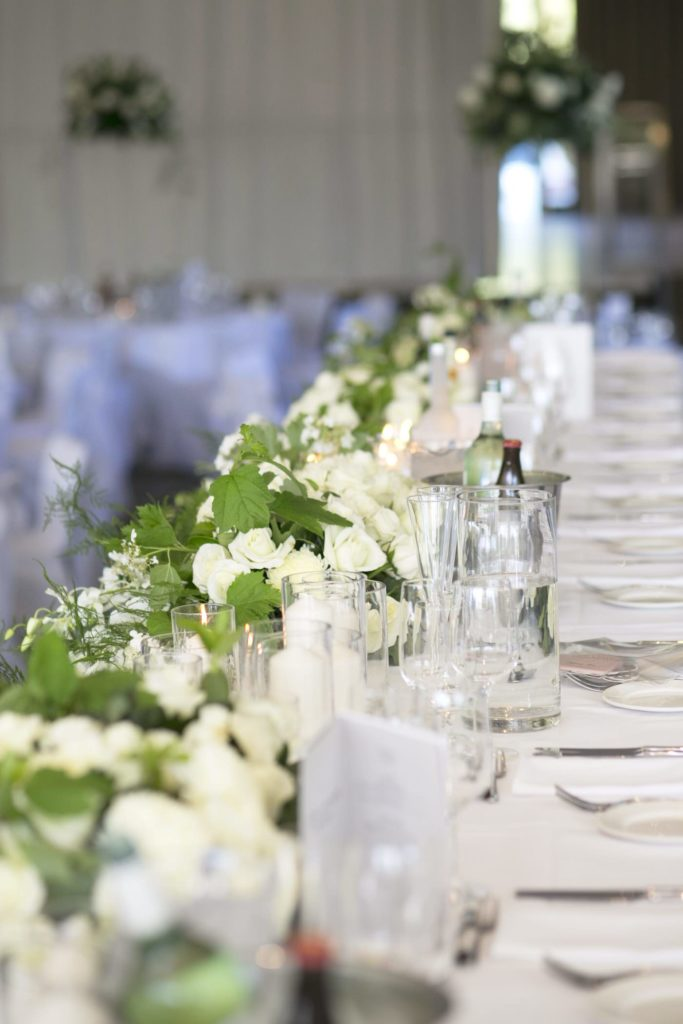 LOVE this headtable with all white roses - See all the beautiful details on B. Lovely Events! #wedding #realwedding #weddingideas #weddingtips #weddingdecorations