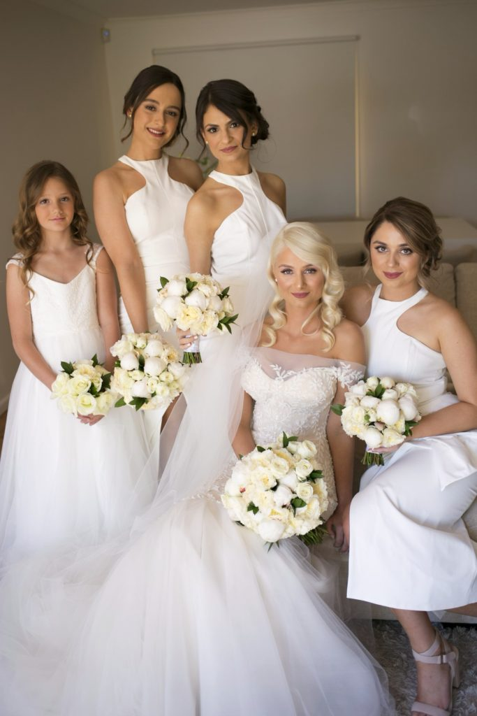 Love the all white bridesmaids dresses - See all the beautiful details on B. Lovely Events! #wedding #realwedding #weddingideas #weddingtips #weddingdecorations