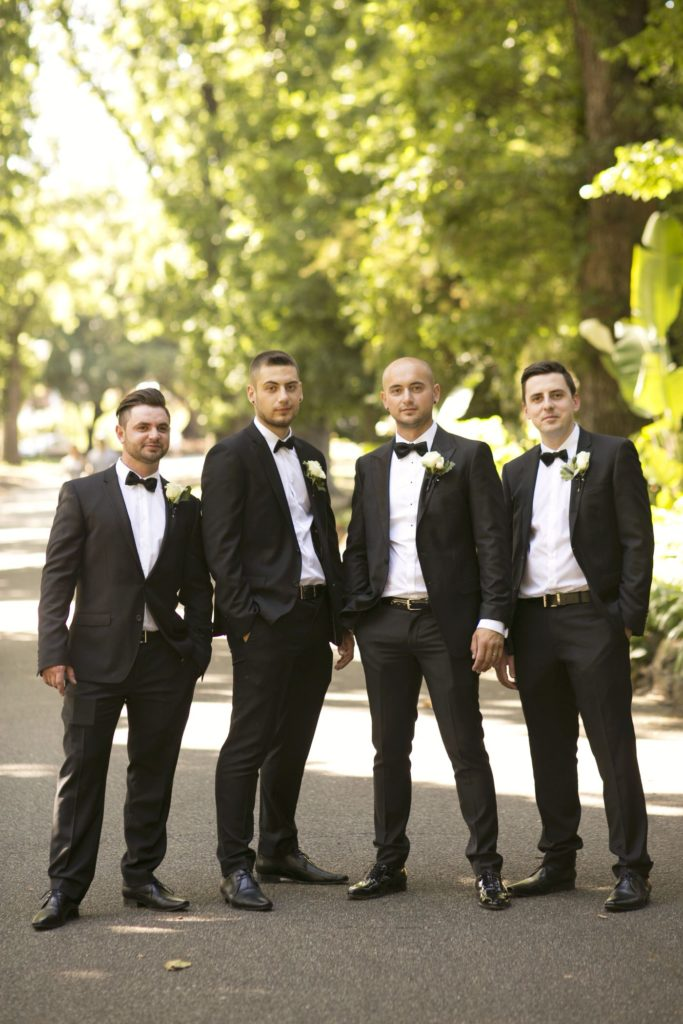 Real Wedding Belinda and michales all white wedding Groomsmen shot - See all the beautiful details on B. Lovely Events! #wedding #realwedding #weddingideas #weddingtips #weddingdecorations