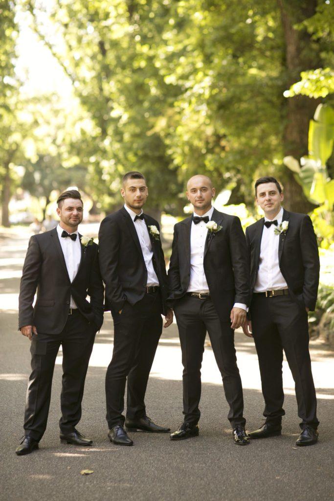 Real Wedding Belinda and michales all white wedding Groomsmen shot - See all the beautiful details on B. Lovely Events! #wedding #realwedding #weddingideas #weddingtips #weddingdecorations