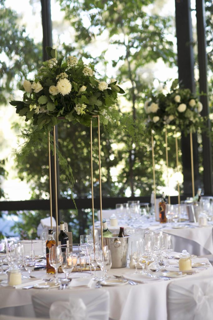 fabulous tall wedding centerpieces with white flowers and leafs - See all the beautiful details on B. Lovely Events! #wedding #realwedding #weddingideas #weddingtips #weddingdecorations