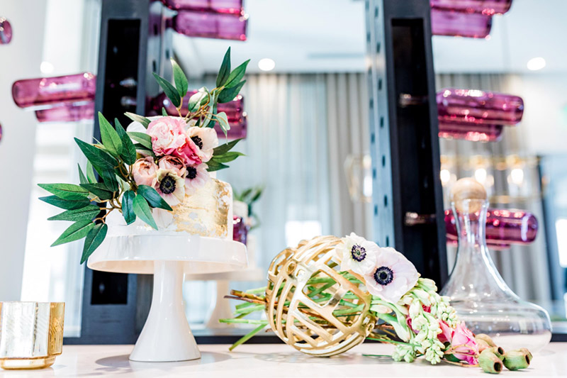 This cake is out of this world amazing! - See all of the details on B. Lovely Events! #valentinesday #tablescape #orchids #anenomies #centerpiece  #goldcake #decoratedcake